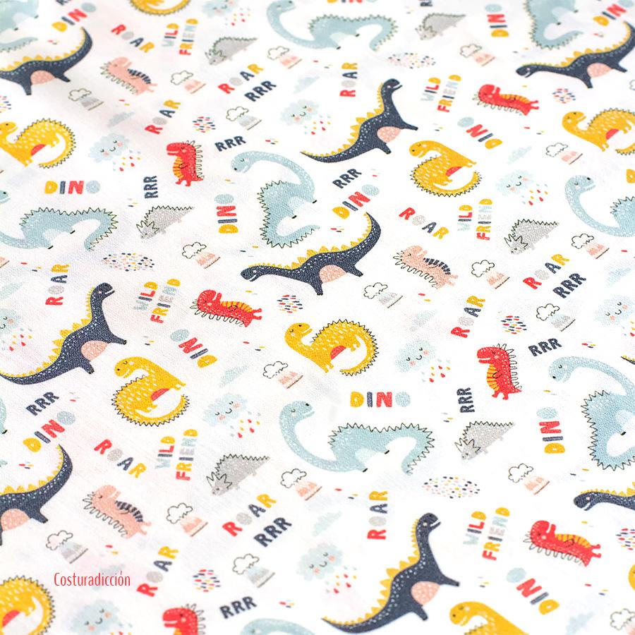 """Imagen del producto: Tela Poppy """"Dinosaurios"""", algodón - 50 x 75 cm"""