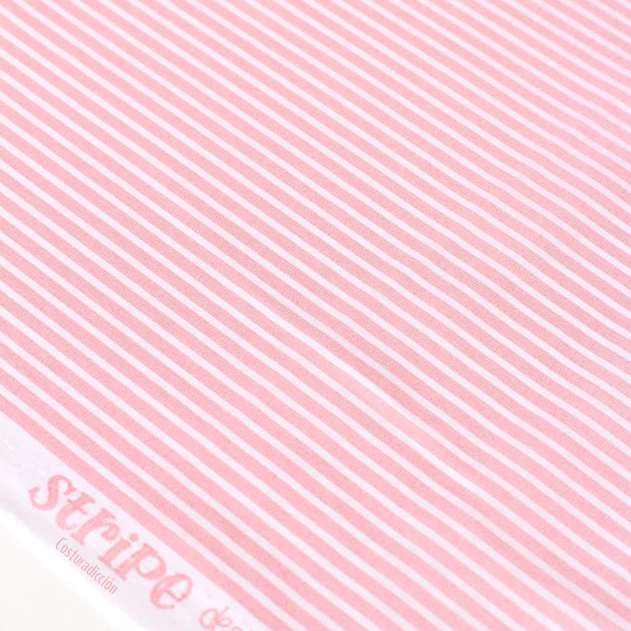 Imagen de producto: https://tienda.costuradiccion.com/img/articulos/secundarias14288-tela-poppy-rayas-rosas-algodon-medio-metro-1.jpg